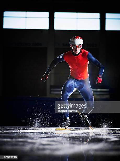 Short track speed skater starting sprint
