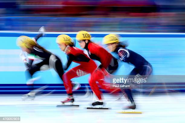 Short track speed skaters compete in the Short Track Ladies' 3000m Relay Final A at Iceberg Skating Palace on day 11 of the 2014 Sochi Winter...