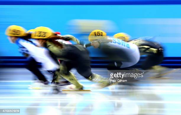 Short track speed skaters compete in the Short Track Ladies' 3000m Relay Final B at Iceberg Skating Palace on day 11 of the 2014 Sochi Winter...