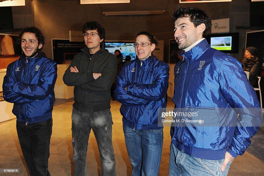 Short track speed skaters Yuri Confortola (L), Cecilia Maffei (2R) and Nicola Rodigari (R) attend the Italia Team Tour Event on March 23, 2010 in Bormio, Italy.