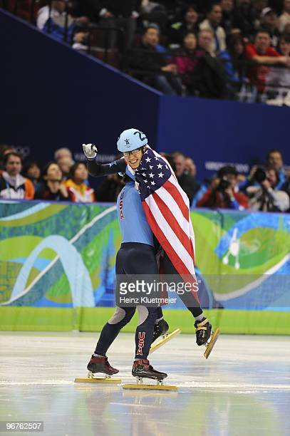 Short Track Speed Skating: 2010 Winter Olympics: USA Apolo Anton Ohno victorious with USA flag and with J.R. Celski during Men's 1500M Finals at...