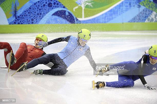 Short Track Speed Skating: 2010 Winter Olympics: USA Katherine Reutter and China Meng Wang in action, fall after crash during Women's 1500M Final at...