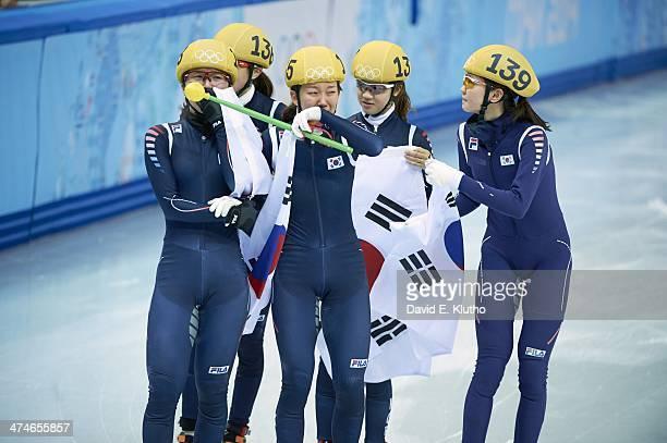 2014 Winter Olympics South Korea Kim Alang Kong Sangieong Park SeungHi Shim Suk Hee and Cho HaRi victorious after winning gold during Women's 3000M...