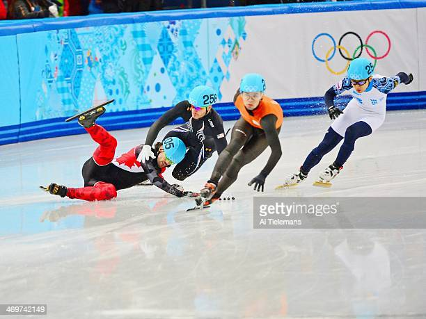 2014 Winter Olympics USA Eduardo Alvarez in action falls after crash with Canada Charles Hamelin during Men's 1000M Final at Iceberg Skating Palace...