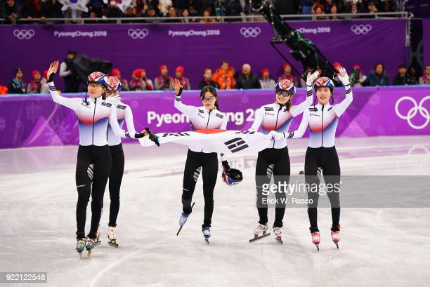 2018 Winter Olympics South Korean team with Shim Sukhee Choi Minjeong Kim Yejin and Kim Alang victorious with flag after winning Women's 3000M Relay...