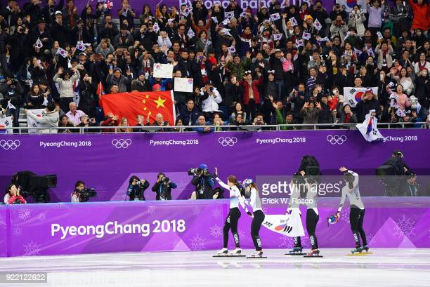 2018 Winter Olympics South Korean team with Shim Sukhee Choi Minjeong Kim Yejin and Kim Alang victorious with flag and waving to fans after winning...