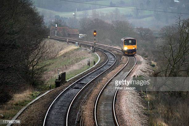 CONTENT] A short train negotiates the curvy track at Ram Hill Coalpit Heath Bristol The train is heading for Bristol Parkway