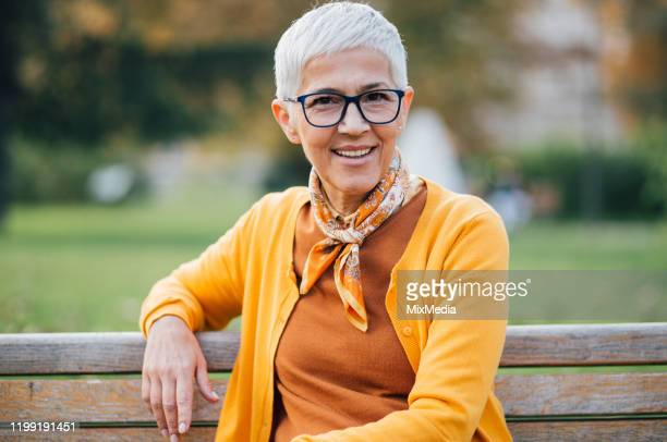 shorthair woman wearing eyeglasses - international womens day stock pictures, royalty-free photos & images
