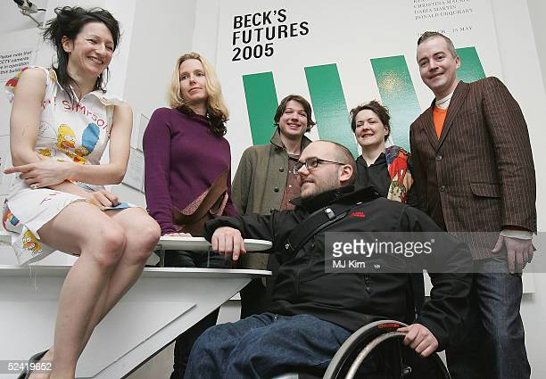 Shortlisted artists Lali Chetwynd Daria Martin Luke Fowler Ryan Gande Christina Mackie and Donald Urquhart pose at the exhibition for contemporary...
