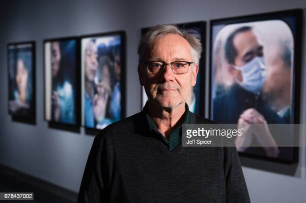 Shortlisted photographer Michael Wolf pictured with his work Work by twelve shortlisted photographers goes on display in the major photography...
