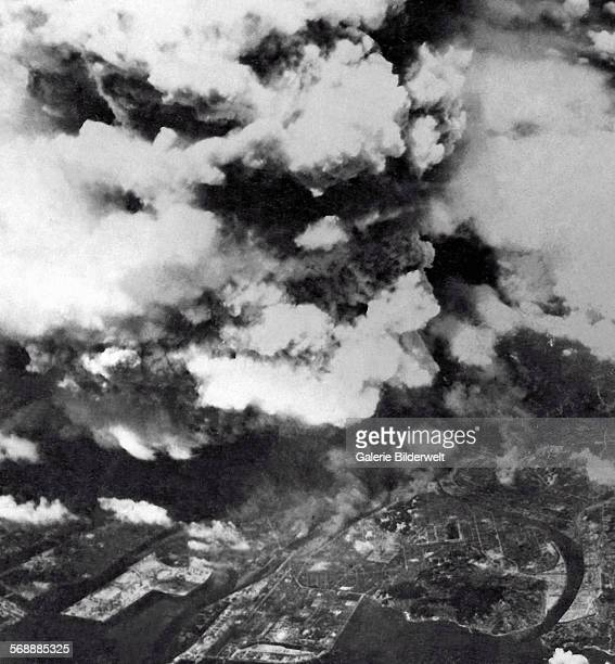 15 am 6th August 1945 Looking down on the rising smoke from the atomic explosion above the city of Hiroshima from an US Air Force bomber from the...