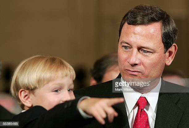 Shortly after arriving for the first day of confirmation hearings US Supreme Court Chief Justice nominee John Roberts eyes his son Jack age 4...