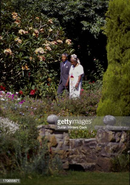 Shortly after his release from prison South African antiapartheid leader Nelson Mandela walks with his wife Winnie Mandela at Desmond Tutu's...