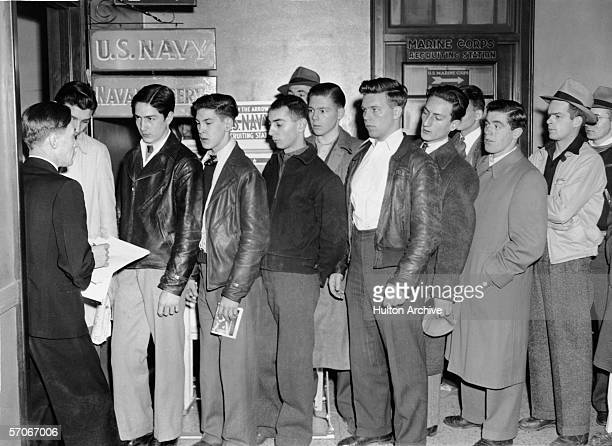 Shortly after the Japanese attack in Hawaii's Pearl Harbor young men line up to volunteer at a Navy Recruiting station Boston Massachusetts December...