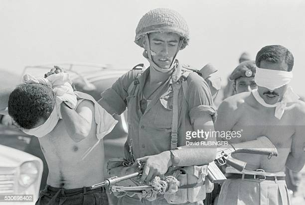 Shortly after the Six Day War Israeli troops arrested these Arabs suspecting them of membership of the underground Fatah All sorts of tricks were...