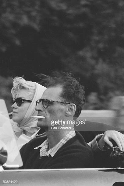 Shortly after their marriage American actress Marilyn Monroe and American playwright Arthur Miller ride in a Thunderbird convertible with Monroe's...