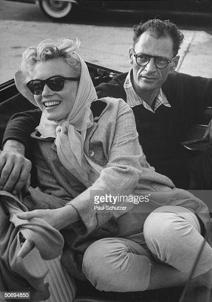 Shortly after their marriage American actress Marilyn Monroe and American playwright Arthur Miller sit in a Thunderbird convertible on their way to...