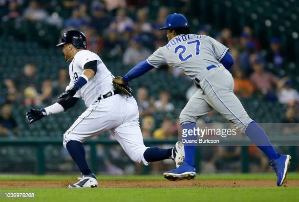 Shortstop Adalberto Mondesi of the Kansas City Royals runs down Victor Martinez of the Detroit Tigers between second and third base on a fielders...