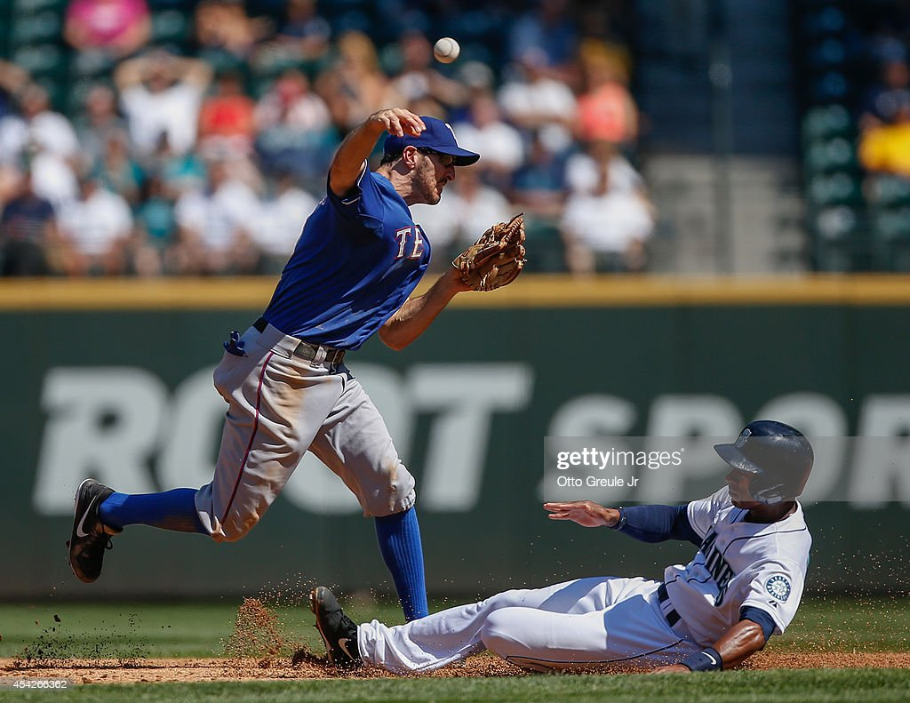 Shortstop Adam Rosales #9 of the Texas Rangers turns a double play over Austin Jackson #16 of the Seattle Mariners to end the third inning at Safeco Field on August 27, 2014 in Seattle, Washington. The Rangers defeated the Mariners 12-4.