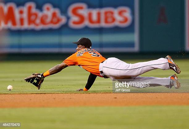 Shortstop Adeiny Hechavarria of the Miami Marlins dives for a ball hit by Josh Hamilton of the Los Angeles Angels of Anaheim but can't make the play...