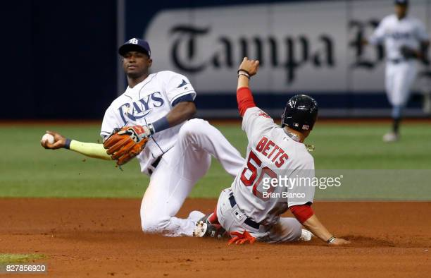 Shortstop Adeiny Hechavarria of the Tampa Bay Rays gets the forced out at second base on Mookie Betts of the Boston Red Sox off of the fielder's...