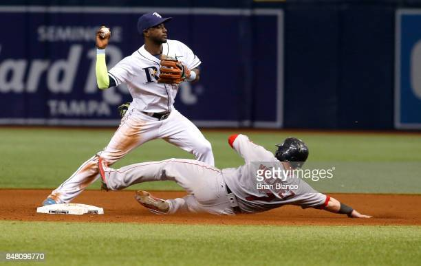 Shortstop Adeiny Hechavarria of the Tampa Bay Rays gets the forced out on Christian Vazquez of the Boston Red Sox at second base off of the fielder's...