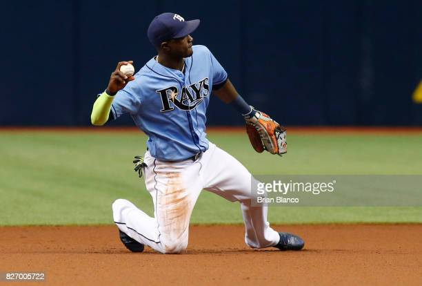 Shortstop Adeiny Hechavarria of the Tampa Bay Rays hauls in the ground ball by Ryan Braun of the Milwaukee Brewers and starts off the double play to...