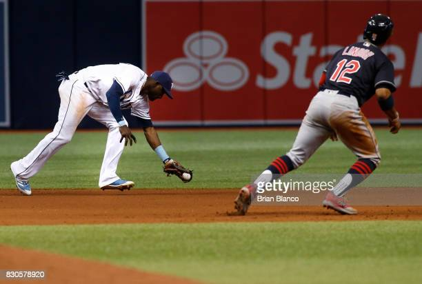 Shortstop Adeiny Hechavarria of the Tampa Bay Rays hauls in the line out by Edwin Encarnacion of the Cleveland Indians in front of Francisco Lindor...