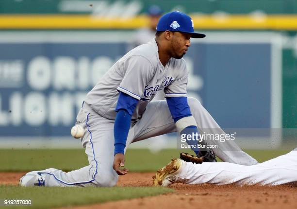 Shortstop Alcides Escobar of the Kansas City Royals can't handle the pickoff throw as Jose Iglesias of the Detroit Tigers steals second base during...