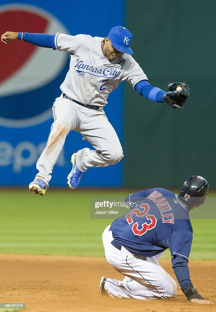 Shortstop Alcides Escobar #2 of the Kansas City Royals jumps over Michael Brantley #23 of the Cleveland Indians to catch a high throw after Brantley stole second during the sixth inning at Progressive Field on April 22, 2014 in Cleveland, Ohio.