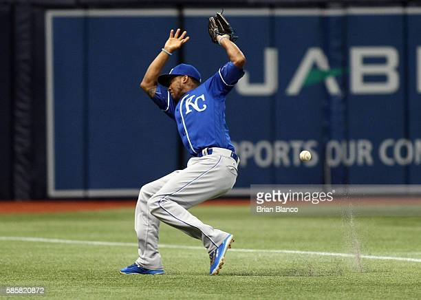 Shortstop Alcides Escobar of the Kansas City Royals makes an attempt on the foul ball by Kevin Kiermaier of the Tampa Bay Rays during the first...