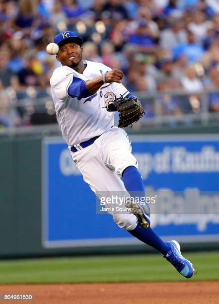 Shortstop Alcides Escobar of the Kansas City Royals throws toward first base during the game against the Minnesota Twins at Kauffman Stadium on June...