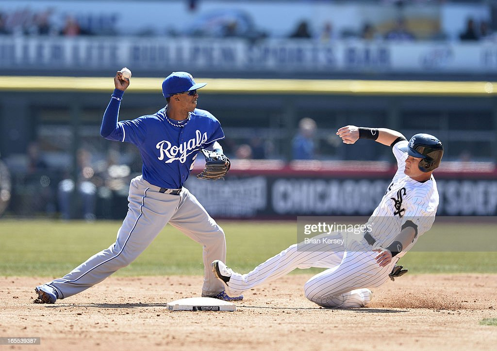 Shortstop Alcides Escobar #2 of the Kansas City Royals (L) turns a double play on a ground ball hit by Alejandro De Aza #30 of the Chicago White Sox as Gordon Beckham #15 slides into second base during the third inning on April 4, 2012 at U.S. Cellular Field in Chicago, Illinois.