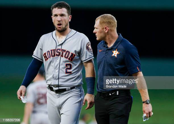 Shortstop Alex Bregman of the Houston Astros leaves the game after being hit the face by the ball during the third inning of a baseball game against...