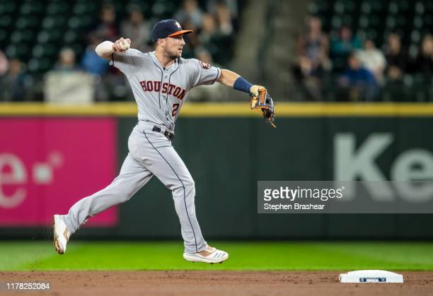 Shortstop Alex Bregman of the Houston Astros throws to first base after fielding a ground ball during a game against the Seattle Mariners at T-Mobile...