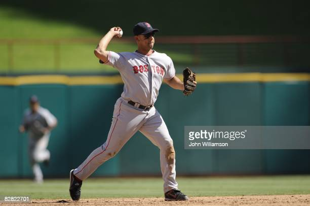 Shortstop Alex Cora of the Boston Red Sox throws to first base after fielding a ground ball during the game against the Texas Rangers at Rangers...