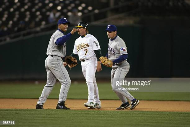 Shortstop Alex Rodriguez of the Texas Rangers celebrates after second baseman Michael Young forced out left fielder Jeremy Giambi of the Oakland...