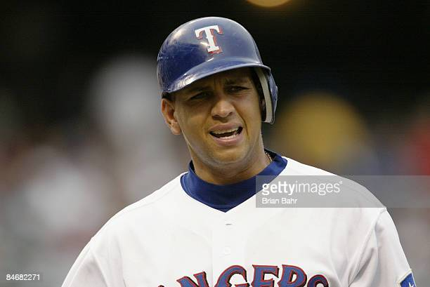 Shortstop Alex Rodriguez of the Texas Rangers complains as he walks back to the dugout after getting called out on strikes against the Boston Red Sox...