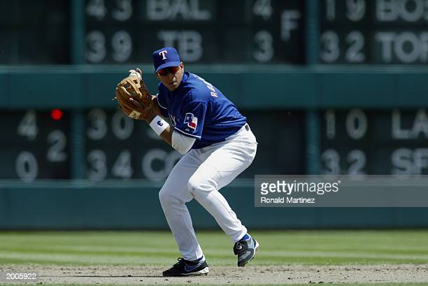 Shortstop Alex Rodriguez of the Texas Rangers throws to first during the game against the Oakland Athletics at the Ballpark in Arlington on April 10...