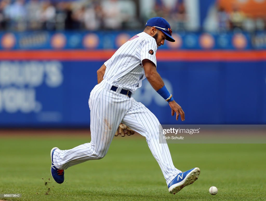 Shortstop Amed Rosario #1 of the New York Mets is not able to come up with the ball cleanly on a single by Pedro Alvarez #24 of the Baltimore Orioles during the eighth inning of a game against the New York Mets at Citi Field on June 6, 2018 in the Flushing neighborhood of the Queens borough of New York City. The Orioles defeated the Mets 1-0.