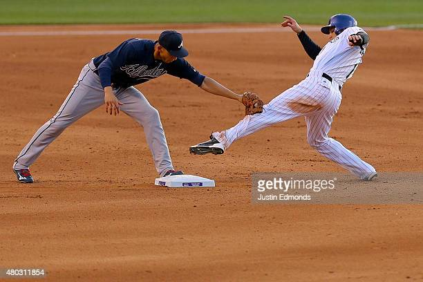 Shortstop Andrelton Simmons of the Atlanta Braves applies the tag to Brandon Barnes of the Colorado Rockies after Barnes was unable to keep his foot...