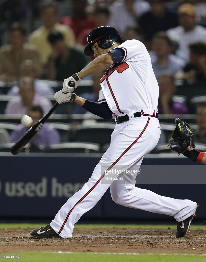 Shortstop Andrelton Simmons #19 of the Atlanta Braves connects for a game tying RBI single in the ninth inning of the game against the Philadelphia Phillies at Turner Field on June 16, 2014 in Atlanta, Georgia.