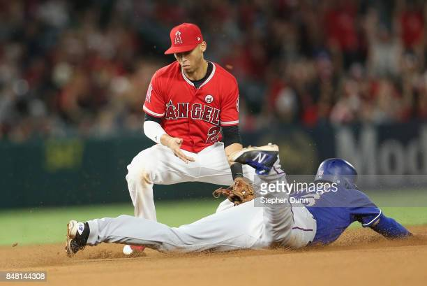 Shortstop Andrelton Simmons of the Los Angeles Angels of Anaheim tags out Joey Gallo of the Texas Rangers attempting to steal second in the seventh...
