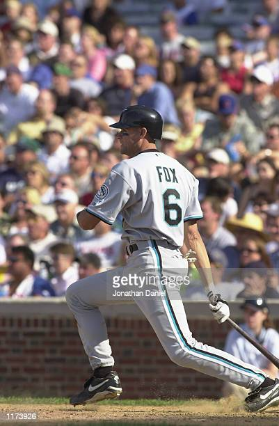 Shortstop Andy Fox of the Florida Marlins eyes his batted ball against the Chicago Cubs during the game on July 12 2002 at Wrigley Field in Chicago...