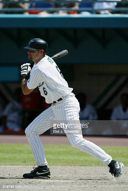 Shortstop Andy Fox of the Florida Marlins follows through during the MLB game against the Arizona Diamondbacks at Pro Player Stadium in Miami Florida...