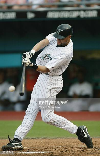 Shortstop Andy Fox of the Florida Marlins swings at a Chicago Cubs pitch during the MLB game at Pro Player Stadium on July 20 2003 in Miami Florida...