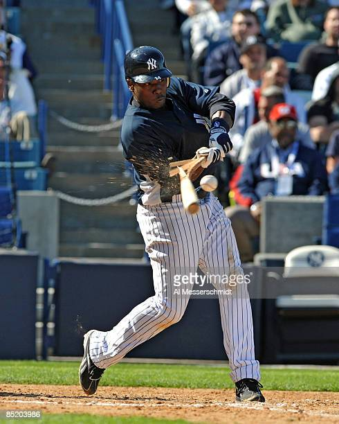 Shortstop Angel Berroa of the New York Yankees breaks a bat against the USA World Baseball team March 3, 2009 at at George Steinbrenner Field in...