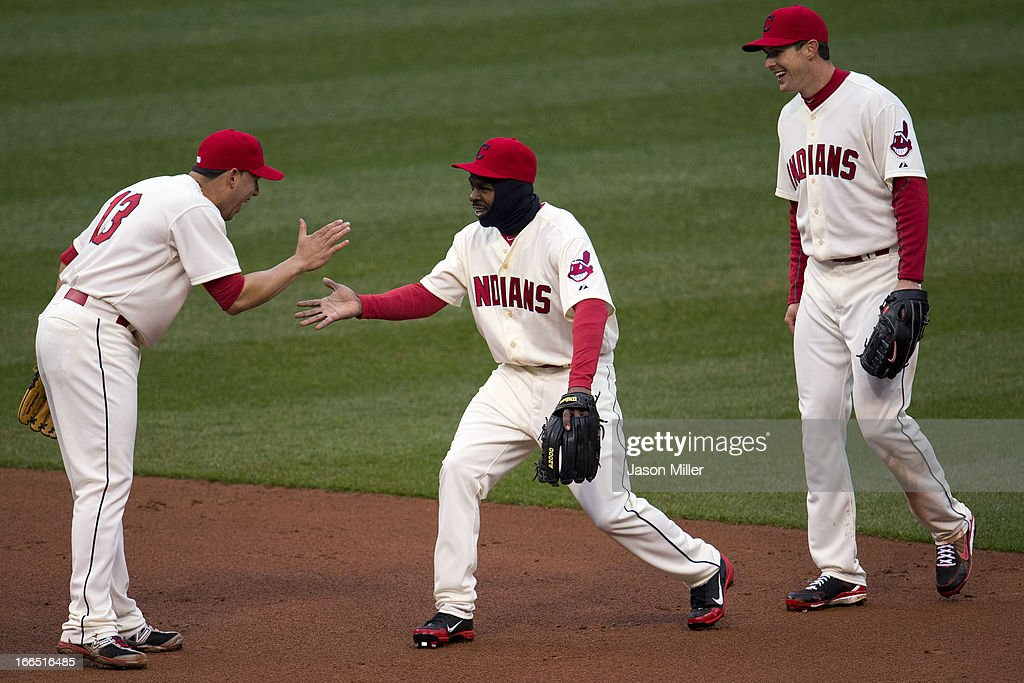 Shortstop Asdrubal Cabrera #13 celebrates with outfielders Michael Bourn #24 and Drew Stubbs #11 of the Cleveland Indians after they defeated the Chicago White Sox at Progressive Field on April 13, 2013 in Cleveland, Ohio. The Indians defeated the White Sox 9-4.