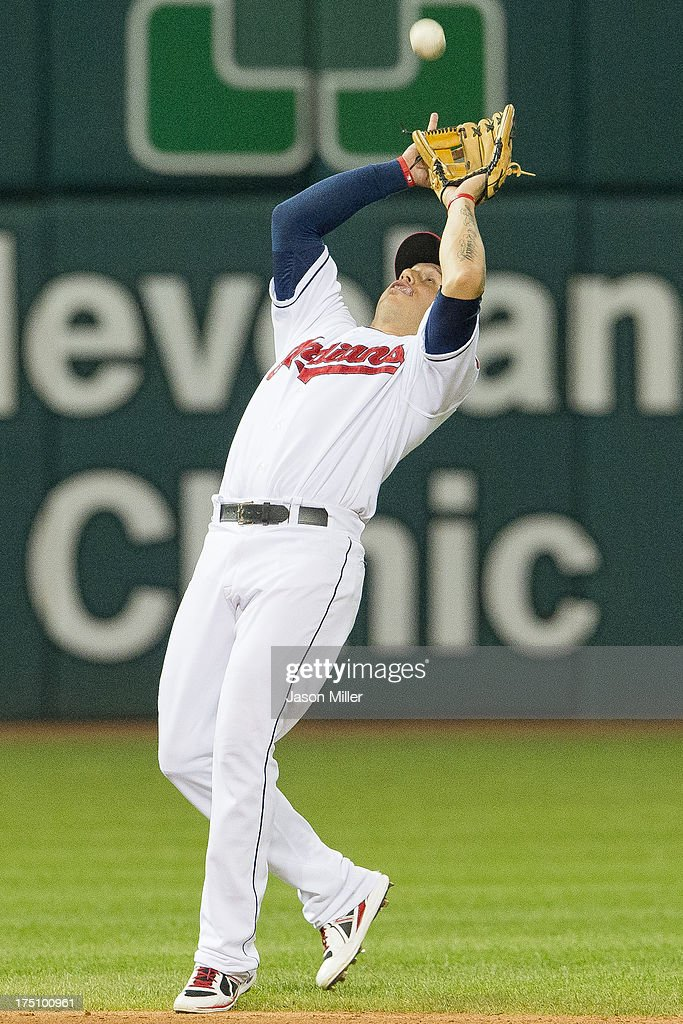 Shortstop Asdrubal Cabrera #13 of the Cleveland Indians catches a pop fly hit by Josh Phegley #36 of the Chicago White Sox to end the top of the seventh inning at Progressive Field on July 31, 2013 in Cleveland, Ohio.