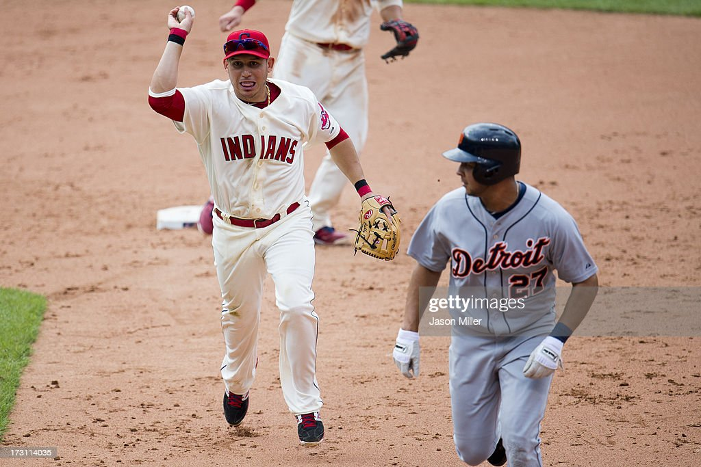 Shortstop Asdrubal Cabrera #13 of the Cleveland Indians runs down Jhonny Peralta #27 of the Detroit Tigers during the ninth inning at Progressive Field on July 7, 2013 in Cleveland, Ohio. The Indians defeated the Tigers 9-6.